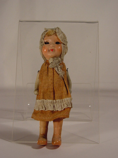 Doll, a small Victorian doll. [Click here to open image in popup]