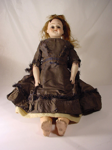 Doll's clothes, dress and doll. [Click here to open image in popup]