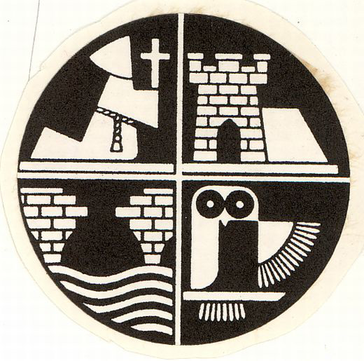 The newly adapted emblem of W. R. Wilkinson & Co Ltd liquorice in the 1990s with a generic castle representing Pontefract in the top right quarter. The emlem or 'seal' was created by the company in the 1940s. [Click here to open image in popup]