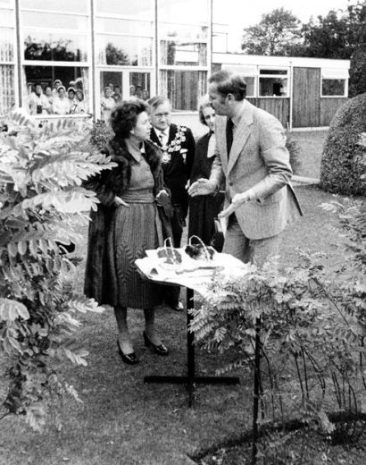 Princess Margaret visits Pontefract. This press photograph shows her at Trebor Bassetts, Monkhill Confectionery Works, escorted by Chris Marshall, the Managing Director, and the Mayor and Mayoress of the District. They are standing by the liquorice hedge outside the canteen. Photograph courtesy of the Pontefract and Castleford Express. [Click here to open image in popup]