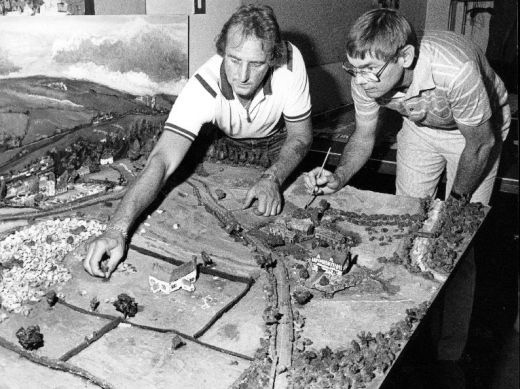 The Occupational Therapy Unit at Pontefract General Infirmary. This press photograph shows Terry Brooks, an occupational therapy helper, and Fred Starks, a technical instructor, putting the finishing touches to a model village made by patients. Photograph courtesy of the Pontefract and Castleford Express. [Click here to open image in popup]
