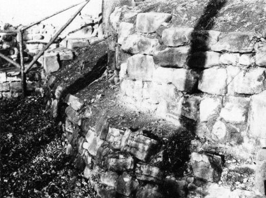 The stonework at the base of the Royal Apartments, looking north towards the Victorian steps leading from the bailey to the upper level [photo 1950-1960] [Click here to open image in popup]