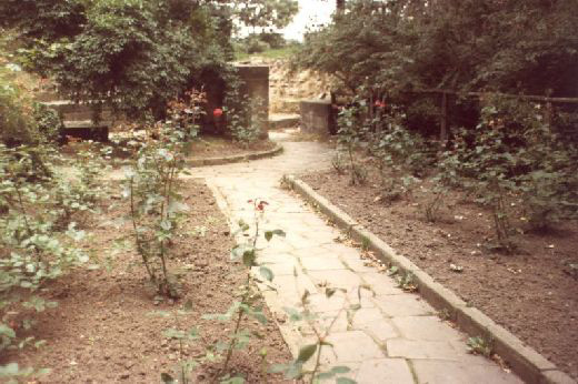 Looking west along the inside of the kitchens towards the back of the ovens. This photo was taken to record the park features which were removed during the consolidation programme of 1984-5 [Click here to open image in popup]