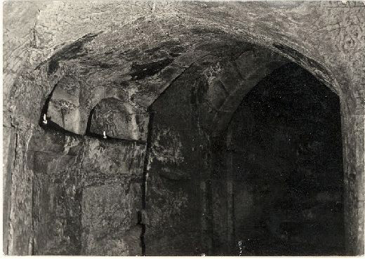 Pontefract Castle, the underground magazine, 1950-1960. The stone niches are highlighted by candles [Click here to open image in popup]