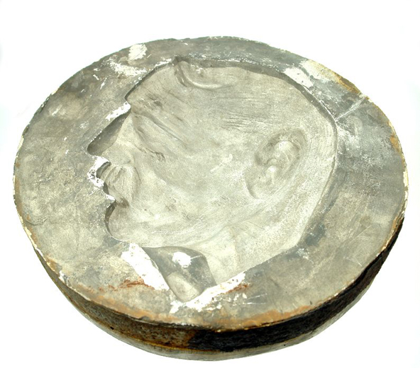 Mould for a plaque showing the head of Neville Chanberlain, Prine Minister from 1937-40, collected from Clokie and Co. Ltd. after the pottery closed in 1961. There is also a plaque made from this mould in the museum collections. [Click here to open image in popup]