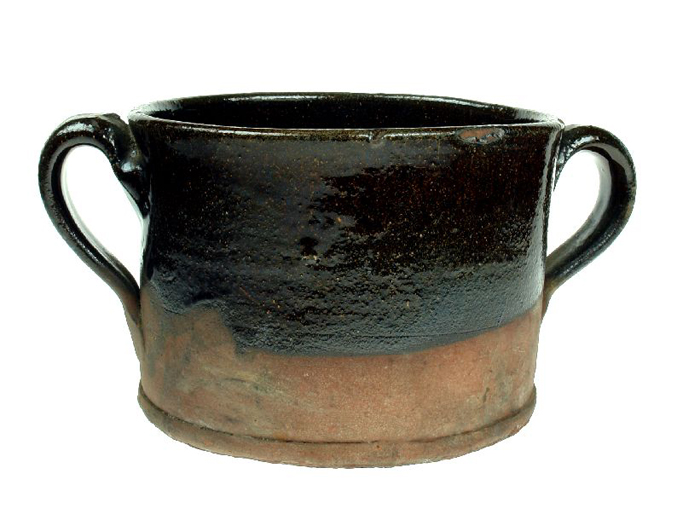 Red earthenware chamberpot found during excavations at HM Prison. It is said to have been made at Castleford in about 1740. [Click here to open image in popup]
