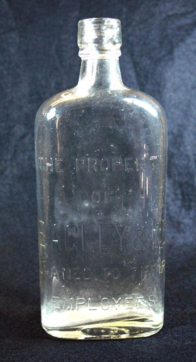 Large clear glass bottle made for Bagley's staff to use on site with water or cold tea in an industry where dehydration was a real danger [because of a nearby pub's 'jug and bottle' take-away facility] safety at work was also compromised. The bottle states the property of Bagley and Co. Ltd. loaned to their employees. [Click here to open image in popup]
