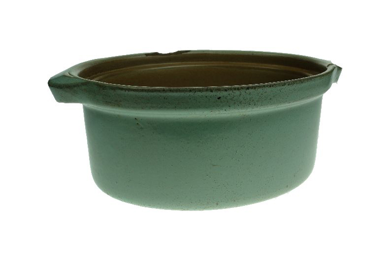 Oval ovenware dish with a light green glaze on the outside, made by Hartley's Ltd. [Click here to open image in popup]