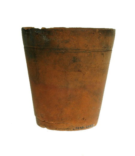 Small red earthenware flower pot made by John Robinson at the Eleven Acres Pottery, Castleford in the early 1900s. [Click here to open image in popup]