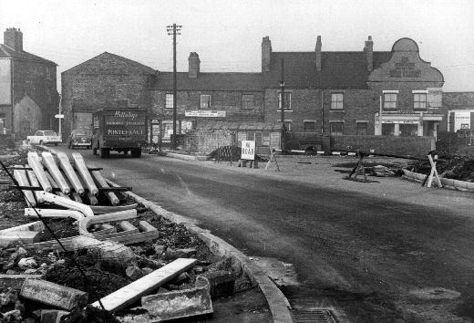 The image shows road works on Thornes Wharf and a Hillabys liquorice van making deliveries. Entrepreneur John Hillaby established the Lion Liquorice Works, Pontefract in 1850. The company grew their own liquorice and by 1893 were the biggest producer in the world. In 1943 the company were taken over by rival producers Joseph Bellamy & Sons Ltd of nearby Castleford. [Click here to open image in popup]