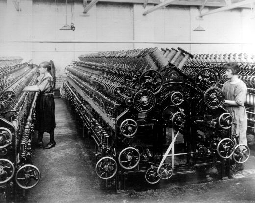 Copy of a black and white photograph of two female spinning operators at working at M.P. Stonehouse in Albion Mills in Wakefield in 1923. M.P. Stonehouse was worsted spinner founded in 1853 by Mathew Porritt Stonehouse and was based at Albion Mills in Wakefield. The factory's main focus was carding and spinning uncombed worsted yarn for carpets and for hand-knitting. [Click here to open image in popup]