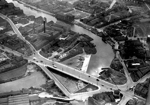 An aerial view of the new and old bridges over the Calder, with the docks and mills of Calder waterfront beyond. Picture copyright of Yorkshire Post Newspapers. [Click here to open image in popup]